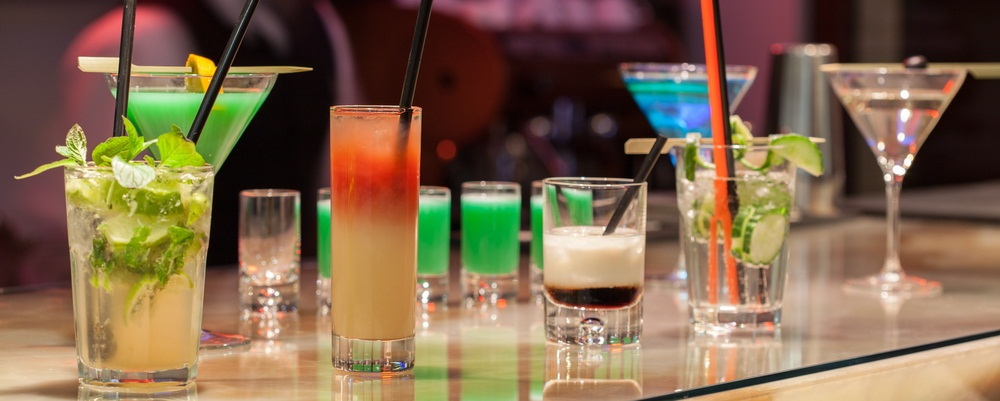 Several cocktails on a table.